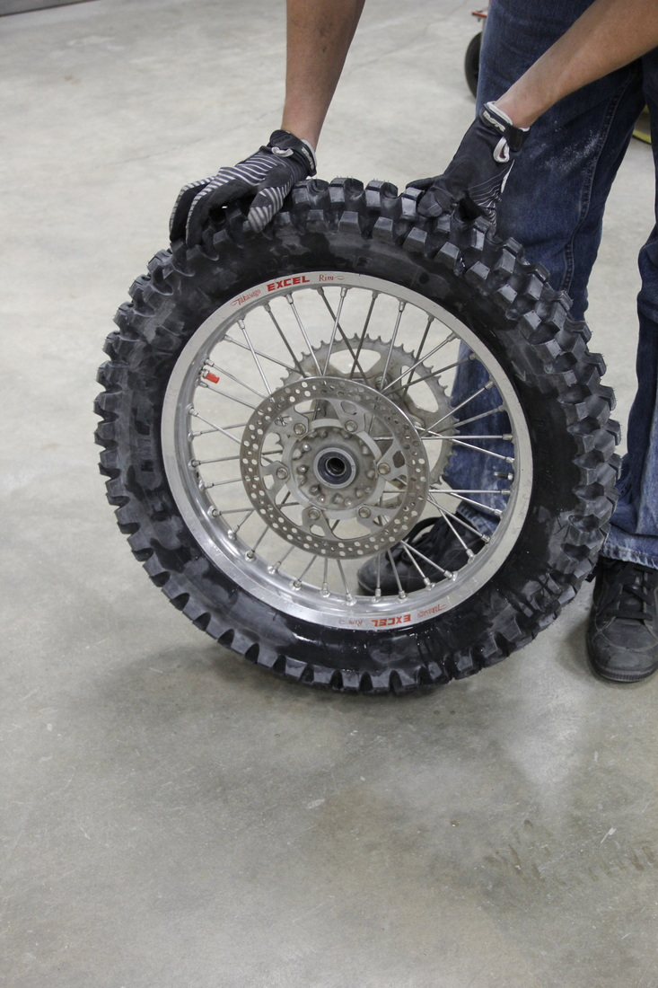 an ice tire that is ready to be studded