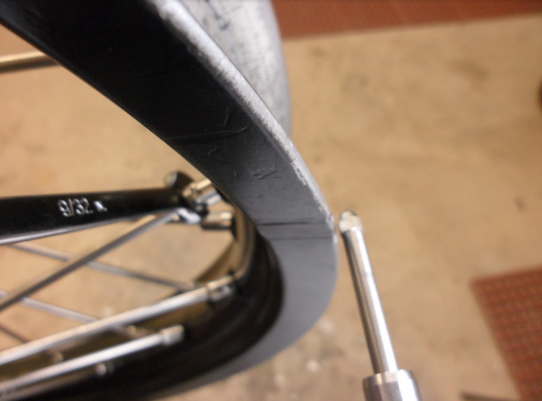 Example of checking runout on a dirt bike rim